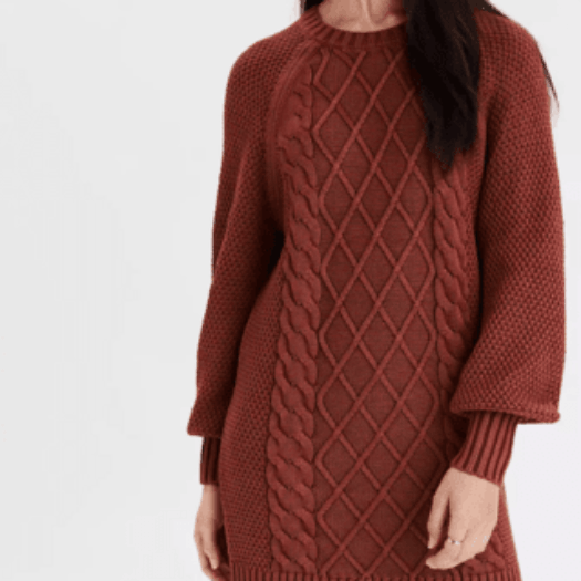 close up of acid wash cable knit sweater dress