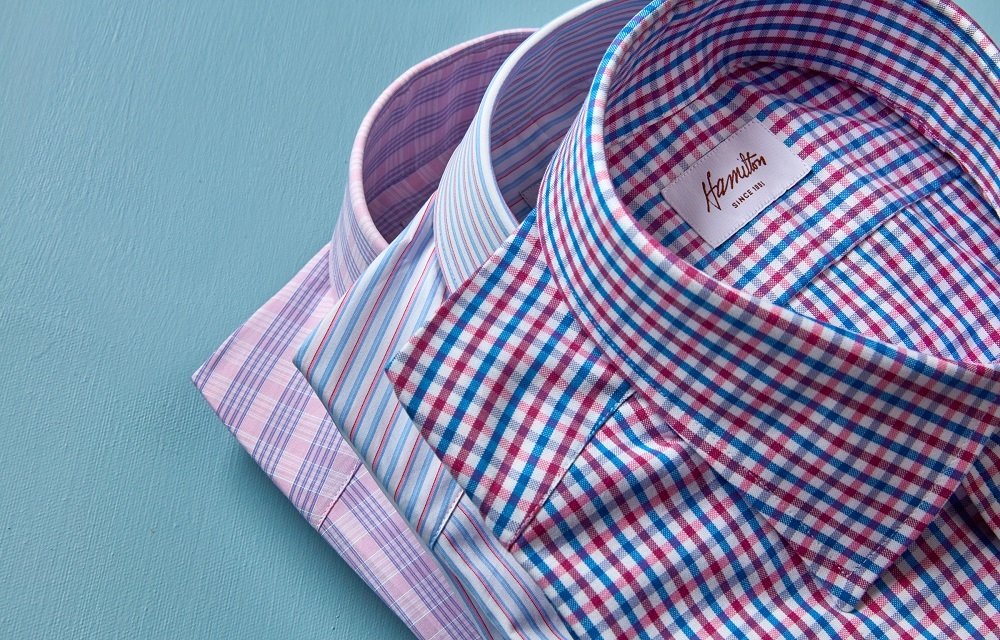 close up of three mens hamilton dress shirts checkered, striped and plaid