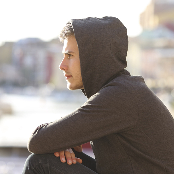 guy in hoodie for versatile cotton athleisure looks for men cotton collection